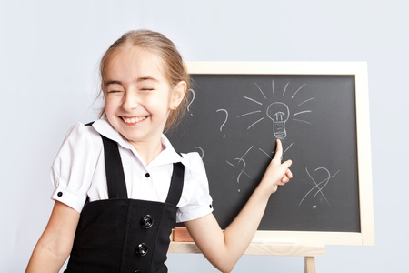 white chalks: schoolgirl about a schoolboard made the correct decision Stock Photo