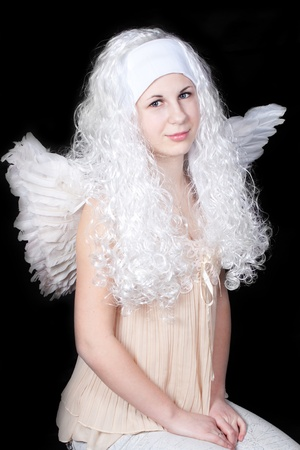 Gentle angel with long white hair photo