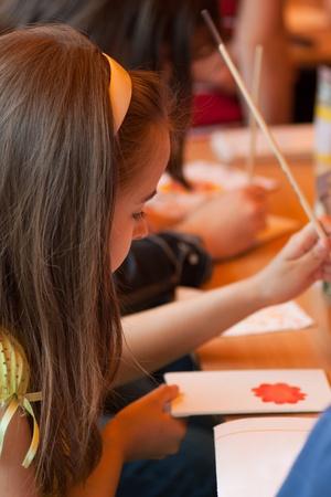 group of children draws paints 版權商用圖片
