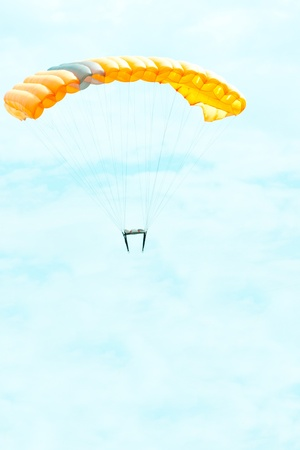 diving save: parachutist in the blue sky on a parachute