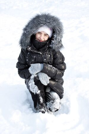 girl on white snow photo