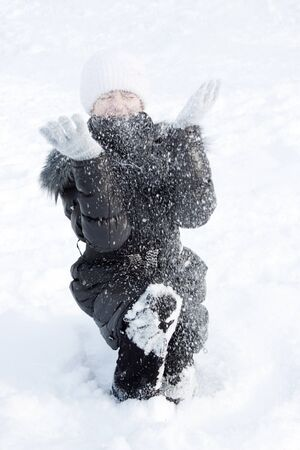 girl plays to snow and throws snow Stock Photo - 11534284