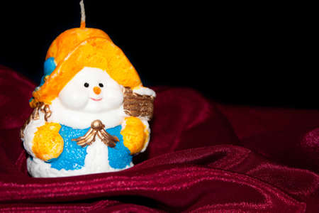 Candle the snowman (Christmas, new year) photo