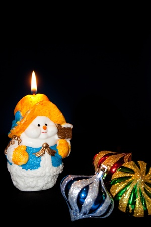 Flame of a candle of the snowman (Christmas, new year) Stock Photo - 11534290