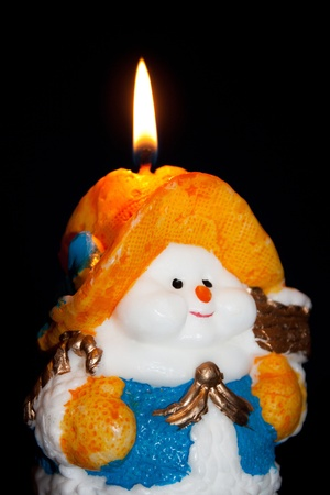 Flame of a candle of the snowman (Christmas, new year) photo