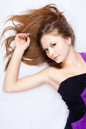 beautiful harmonous young woman with long hair lying on a back photo