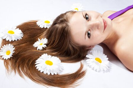 Close-up of a beautiful, young woman with white flowers photo