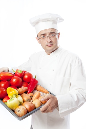 Cook man with vegetables. Isolated over white Stock Photo - 12511916
