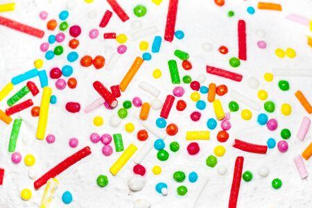 background small candies on sugar glaze photo