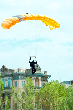 parachutist in the blue sky on a parachute photo