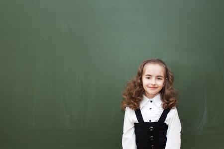 small schoolgirl about a blackboard