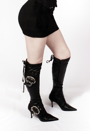harmonous feet of the girl in high leather boots