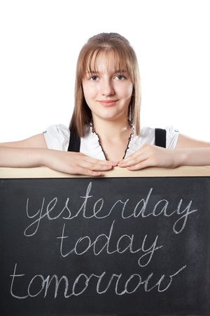 girl the student about a blackboard with inscriptions today, tomorrow, yesterday