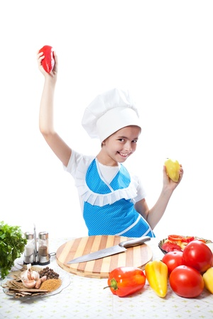 Happy little chef cook dancing with Bell Pepper photo