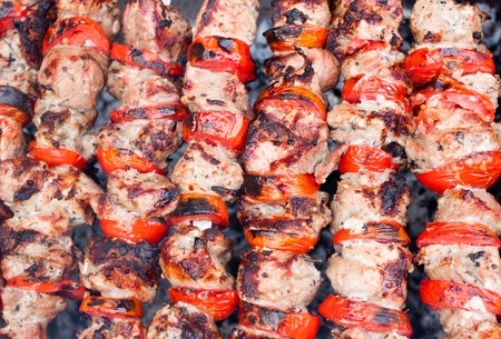 Juicy roasted kebabs on the BBQ photo