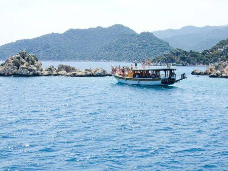 Tourist ferry against mountains Stock Photo - 16601083