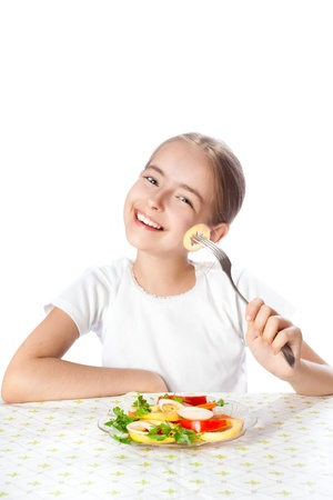 Close-up of young happy woman eating salad photo