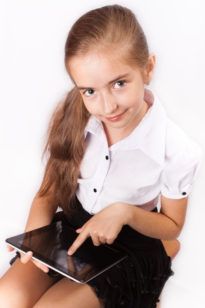 Girl with ipad like gadget isolated white background photo