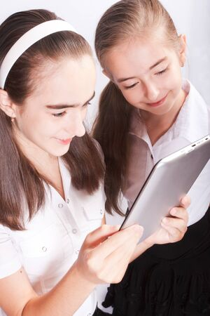 Two teenager with ipad like gadget photo