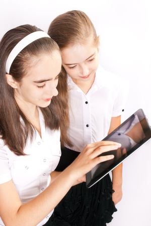 Two teenager with ipad like gadget Stock Photo - 18630994