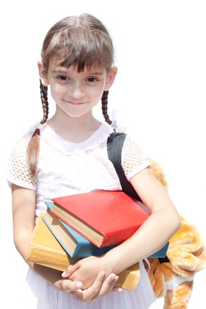 little Girl schoolgirl holding books photo