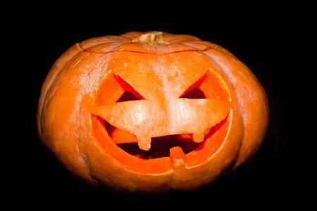 hollows: Halloween pumpkin lantern candle in the dark