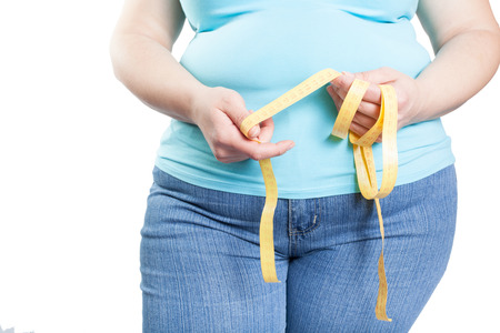 girl with overweight (obesity) with a tape of measurements isolated on white Banque d'images