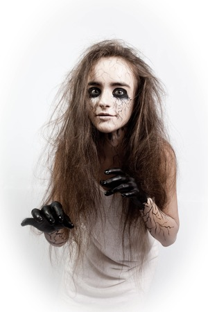 portrait of a crazy girl with disheveled hair, black eyes and veins. concept of halloween and day of the dead.