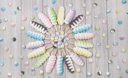 Colorful meringue lollipop on a gray background. 版權商用圖片