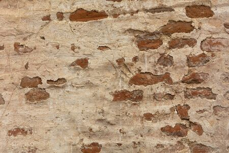 Old brick wall and white stucco texture. Grunge red stone wall, shabby building facade with damaged stucco. Abstract pattern, copy space. 版權商用圖片