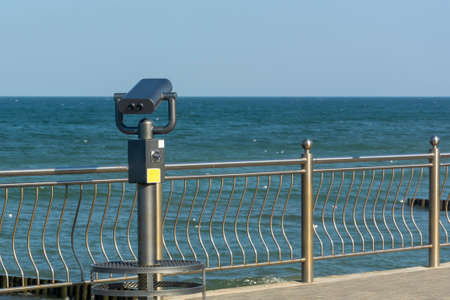 Public binoculars by sea. Coin-operated binocular viewer for tourists.