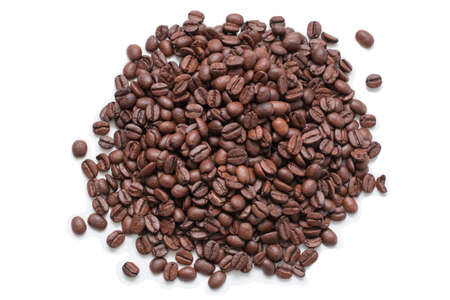 Many coffee beans are heaped. Isolated over white background.