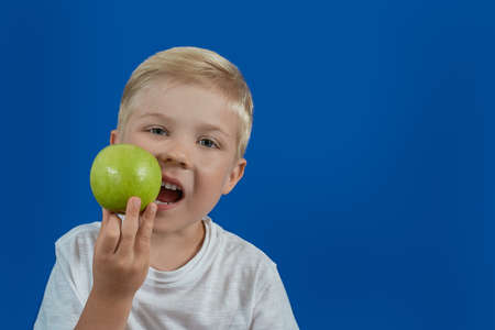 Child eating a green apple