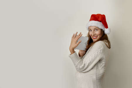 A pregnant woman mother in santa hat