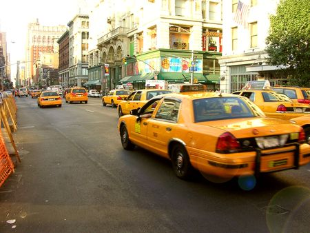 Yellow car attack Stock Photo