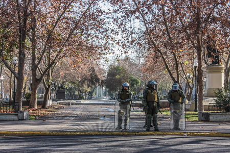 quell: SANTIAGO, CHILE - 23 JUNE 2011: police stand guard during a protest