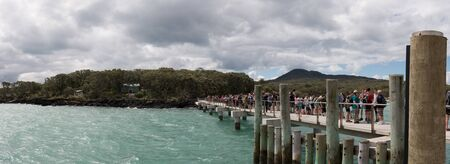 AUCKLAND, NEW ZEALAND - December 07, 2015:  Passengers waiting for the ferry at Rangitoto Island.