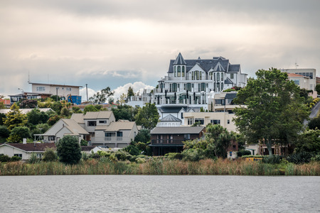 Hamilton, new Zealand - March 26, 2017: View of beautiful houses from Hamilton Lake Domain in New Zealand.