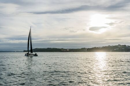 Auckland, New Zealand - May 23, 2017: Frank Racing catamaran sails for training session in Auckland harbour.