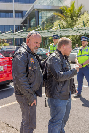Wellington, New Zealand - October 28, 2017: National Front members made their way to Parliament against Protesters at New Zealand Parliament Building for inclusion and diversity hosted by Migrant & Refugee Rights Campaign.