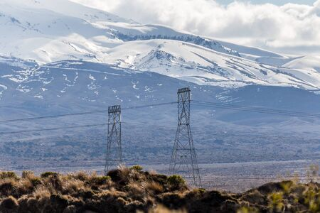 Electricity pylon in a field in New Zealand. Stock Photo