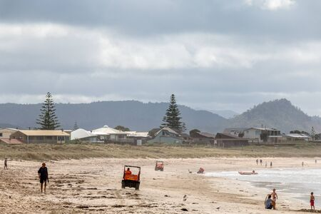 Whangamata, New Zealand - March 20 2017: Lifeguards stage  a mock rescue on one of the remote beaches of Coromandel Peninsula, New Zealand