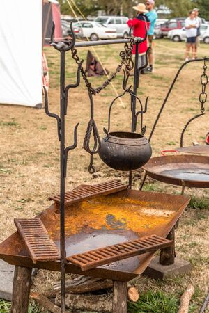 Levin, New Zealand - February 10, 2018: Open fire pit at a medieval market in Levin showgrounds, New Zealand. Editorial
