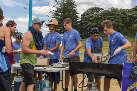 Mount Maunganui, New Zealand - December 31, 2017: Charity sausage sizzle at Mount Maunganui beach, New Zealand