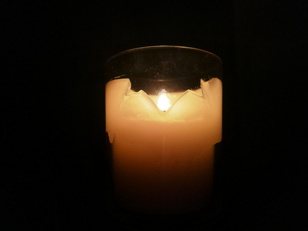 Candle Burning in a Glass Holder