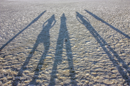 People shadow Salar the Atacama, Chile