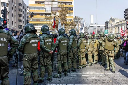 Santiago, Chile - May 12, 2011: Police stand guard during a protest in Santiago, Chile.