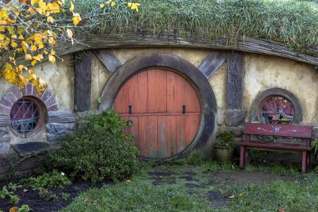 Matamata, New Zealand - June 07, 2017: Hobbit house at Hobbiton, a movie set created for the filming of the Lord of the Rings and The Hobbit movies.