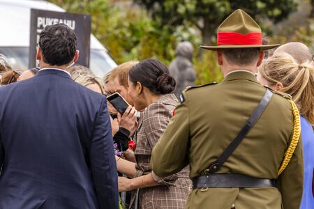 Wellington, New Zealand - October 28, 2018: The Duke and Duchess of Sussex chat with members of the crowd at the Wellington War Memorial in New Zealand.