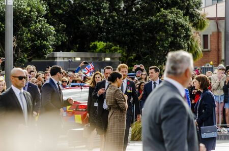 Wellington, New Zealand - October 28, 2018: The Duke and Duchess of Sussex approach the crowd at the Wellington War Memorial in New Zealand.
